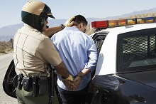 Person being arrested for a misdemeanor by a police officer