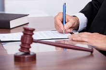 Person signing legal papers